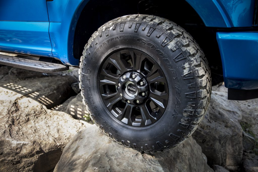 """35"""" GoodYear Wrangler DuraTrac Tires and matte-black 18"""" wheels are standard on 2020 SuperDuty trucks equipped with the Tremor Off-Road Package."""
